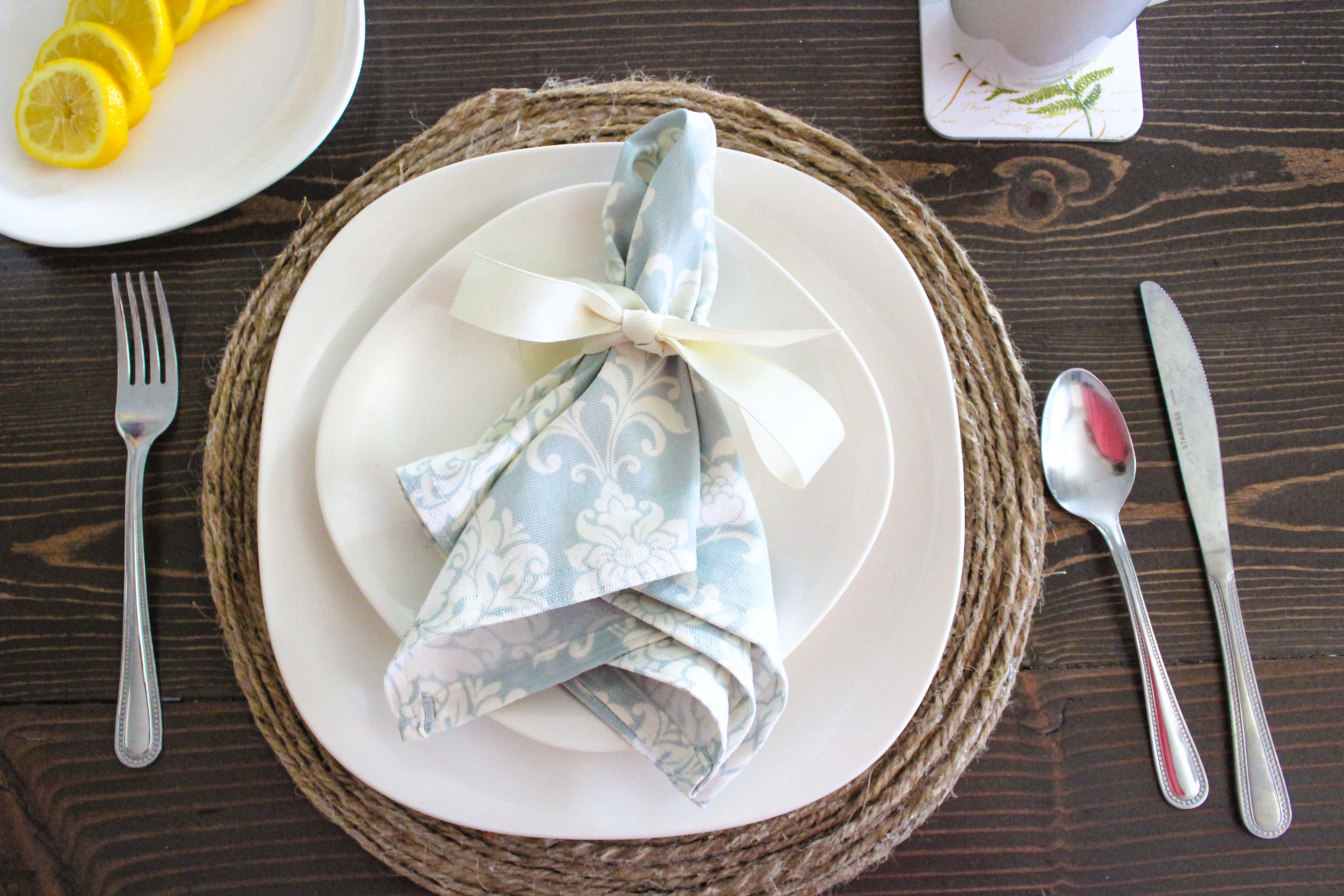 Blue floral cloth napkin on a white plate
